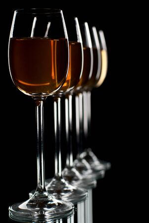 Set of wineglasses filled with wine. Stock Photo