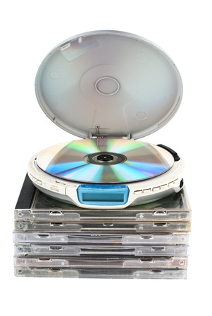 CD-player with compact discs. White background. Studio shot. Stock Photo