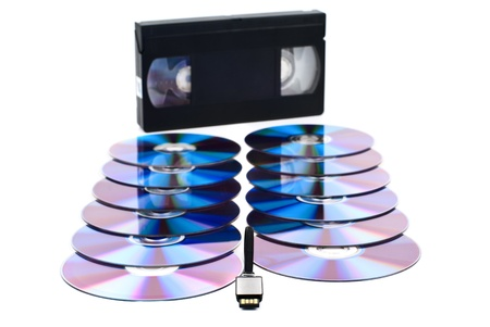 USB flash drive with CDs and video tape. White background. Studio shot. Stock Photo