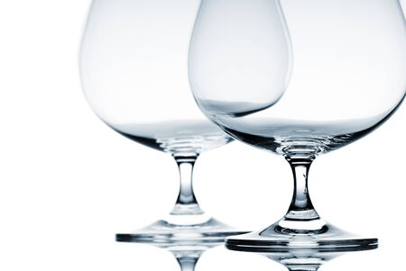 Two empty glasses for brandy on white background Stock Photo - 12927243
