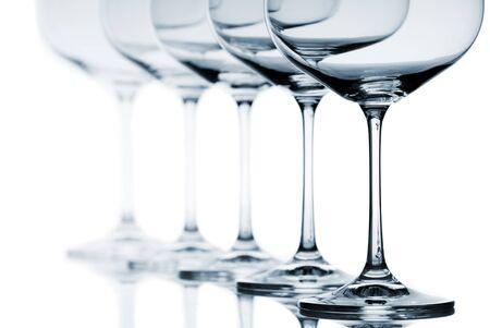Set of empty wine glasses on white background
