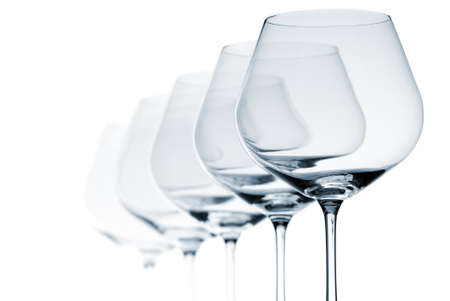 bar ware: Set of five empty wine glasses on white background