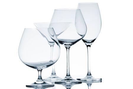 Set of empty glasses on white background