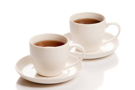 Two cups of tea on white background. Studio shot Stock Photo