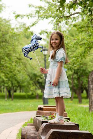 Little girl in summer park. Stock Photo - 18708798