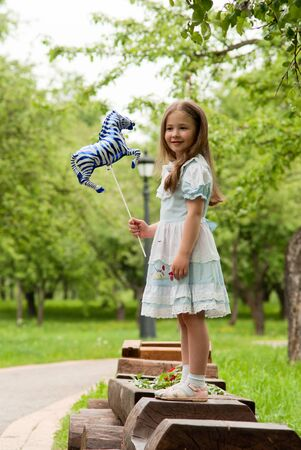 Little girl in summer park. Stock Photo - 18708798
