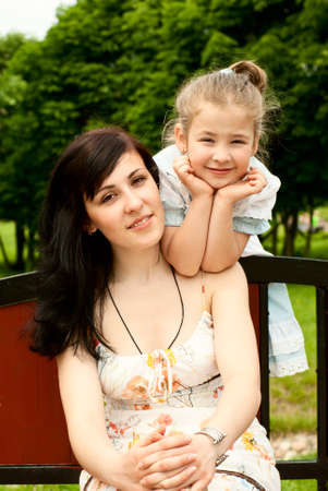 Picture of two sisters in summer park Stock Photo - 18708796