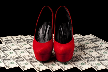 Pair of red female shoes and dollars on black background  Studio shot  Standard-Bild