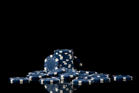 set of blue poker chips on black background. Studio shot Stock Photo
