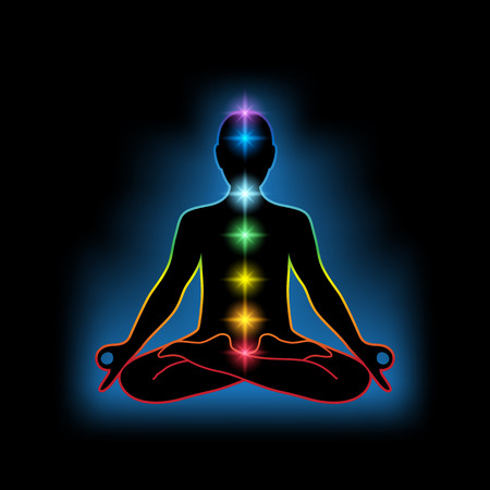 Black silhouette of a human in lotus position with colrful chakras