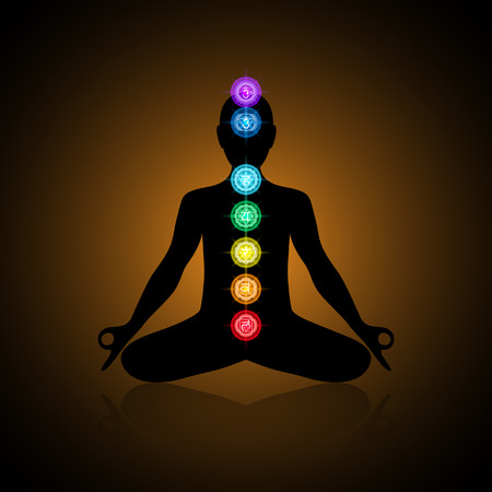 anahata: Black silhouette of a human in lotus position with colrful chakras