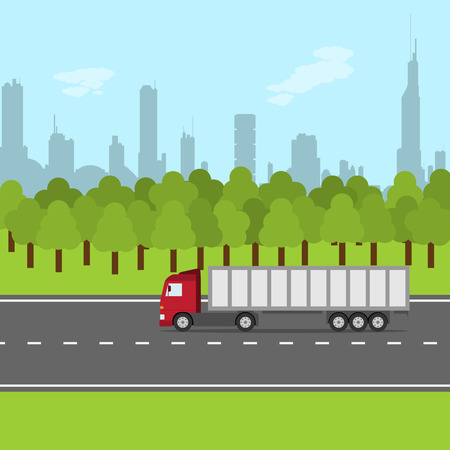 picture of truck on the road with forest and city silhouette, transportation concept