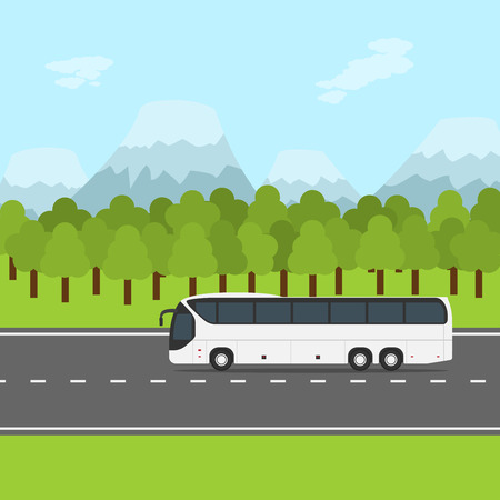 autobahn: picture of a bus on the road, with forest and mountains on background