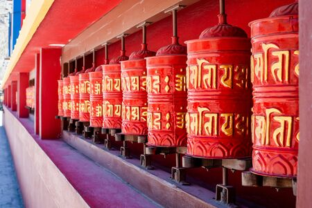 Picture of buddhist prayer wheels in a row