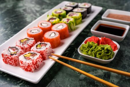 Japanese sushi set with soy sauce, wasabi and pickled ginger