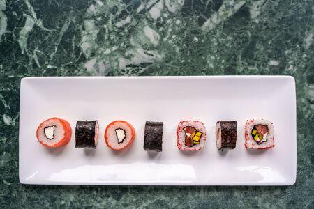 Fresh made sushi set on white plate