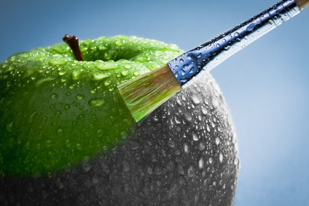 a lifestyle: Green apple as art concept Stock Photo