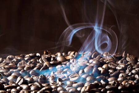 roaster: Fragrant roasted coffee beans on black background Stock Photo