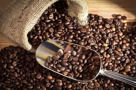 coffee crop: Sack with coffee beans on old plank