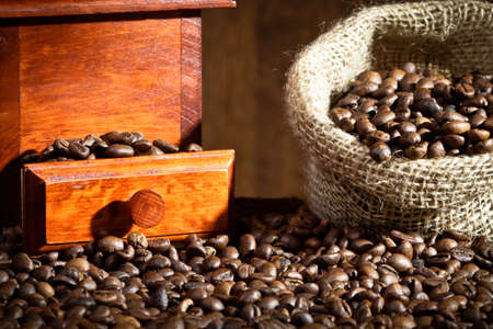 Coffee Grinder with coffee beans sack photo