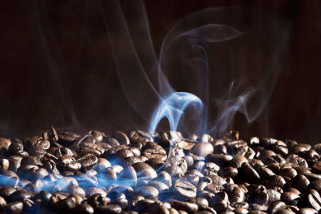 Fragrant roasted coffee beans on black background photo