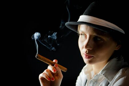 Woman in black hat with cigar Stock Photo - 9339275