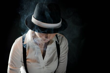 Mistic woman with black hat in smoke under cover photo