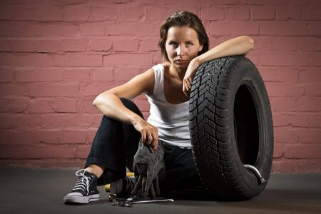 Beautiful mechanic in auto repair shop photo