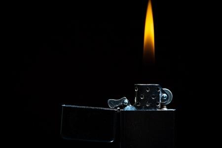 lighter gas: Gas m�s ligero sobre fondo negro Foto de archivo
