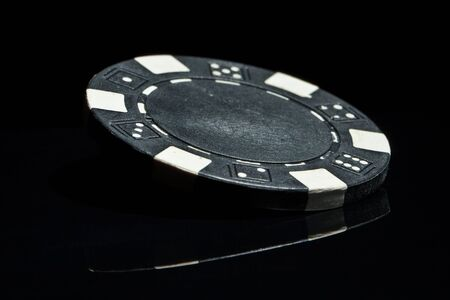 Black chip on black reflection table photo