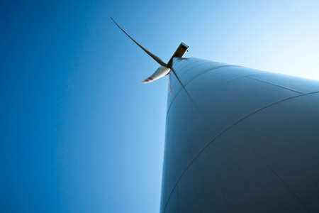 Power generating wind turbines throwing up to the sky photo