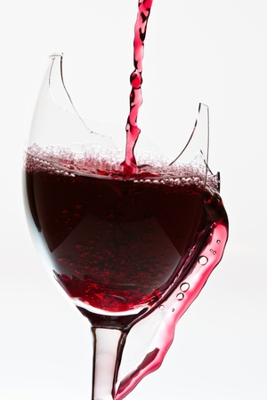 Red wine in broken glass photo
