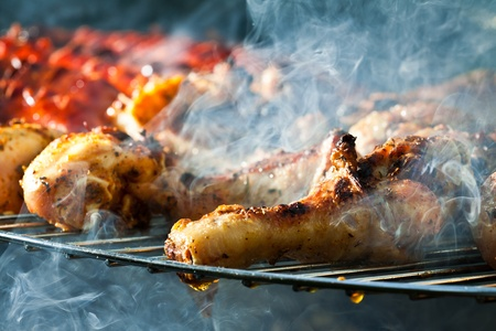 Barbecue with chicken legs on grill