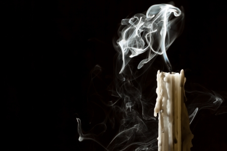 burned out: Candle blow off with smoke Stock Photo