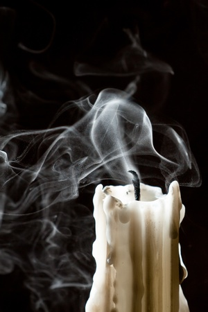 Close up candle with smoke photo