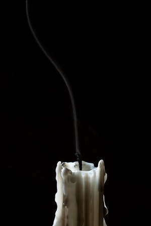 Close up candle with trail smoke photo