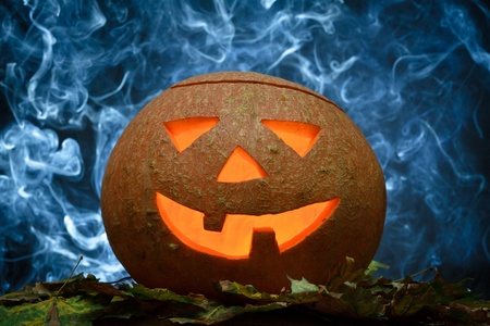 Glowing halloween pumpkin and blue smoke Stock Photo - 10640614