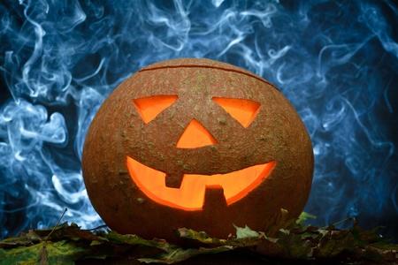 Glowing halloween pumpkin and blue smoke Stock Photo - 10640614