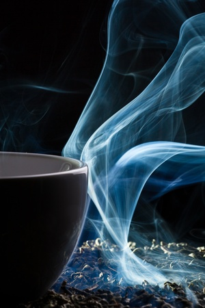 tea hot drink: Tea and smoke on black background Stock Photo