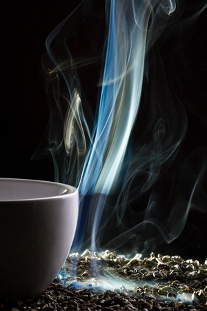 Blue smoke from cup of tea Stock Photo - 10907029