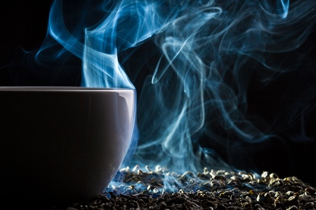 Smell of good tea from a small cup Stock Photo - 10907025
