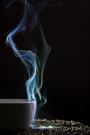 Tea and blue smoke on black background Stock Photo - 10907026