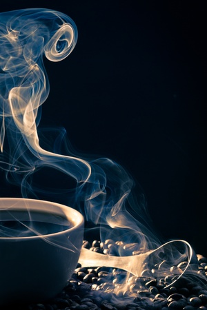 attar: Swirling golden smoke taking away from coffee Stock Photo