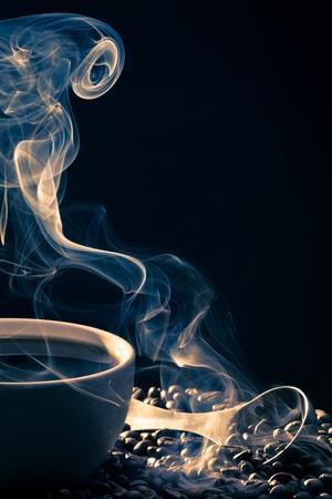 attar: Swirling golden smoke taking away from coffee Stock Photo