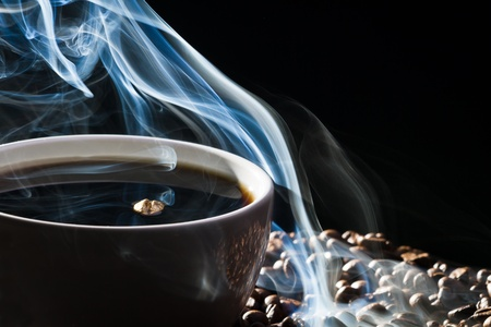 attar: Roasted coffee and cup on black background