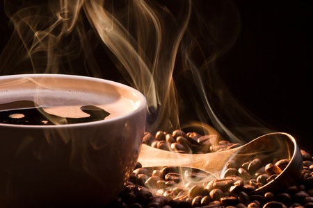 Coffee, smoke and roasred seeds Stock Photo