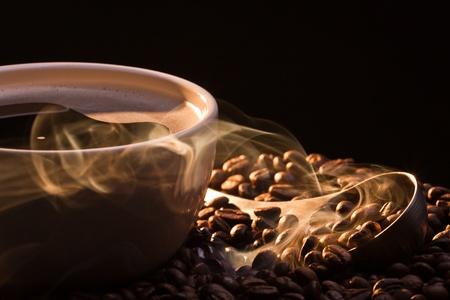 attar: Dry coffee with golden smoke Stock Photo