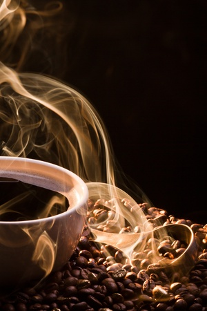 Coffee and smoke on black background photo
