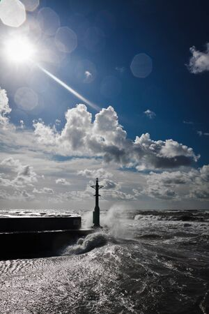 Storm in baltic sea with blue sky photo