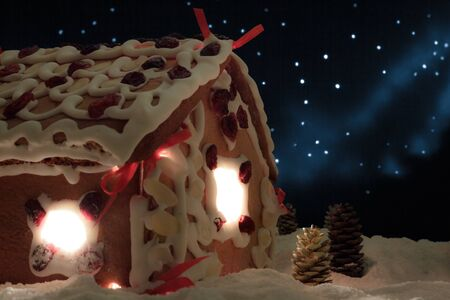 Closeup gingerbread cottage with stars in the background photo